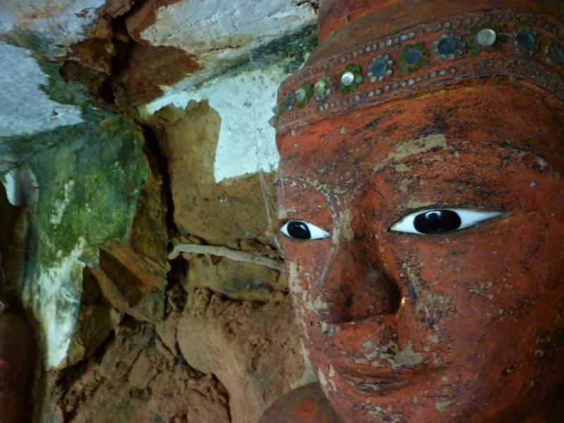 Buddha in badly decayed Cave